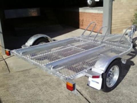 SeaTrail bike trailer. Carries 3 trail bikes or 1 quad bike.Includes loading ramp. $1750.00(quad not for sale)
